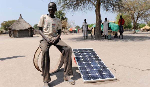 Africa Southern Sudan Rumbek , family use solar home system for electrification